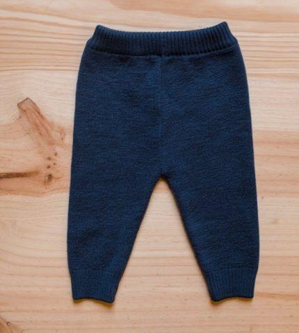 calças (a)